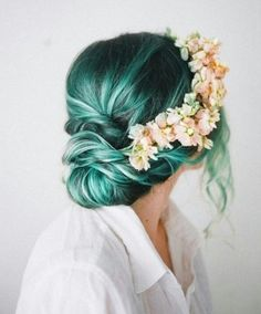 Gorgeous Teal Hair in Low Messy Bun With Flower Head Band.