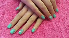 Turquois acrylic nails with round studs