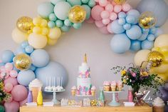 A pastel balloon arch like no other.