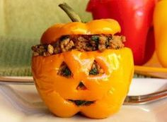 Stuffed peppers that look like jack o' lanterns for Halloween.  Great pre-trick-or-treat dinner idea.