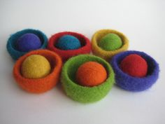 felted wool rainbow bowls and matching balls. $70,00, via Etsy.