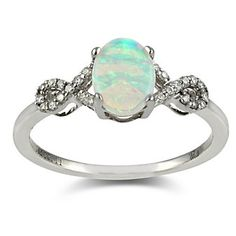 14K Opal and Diamond Ring, I love the Opal this ring is awesome. Love opals! After all, it is my birthstone.