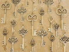 24 Alice in Wonderland silver tibetan skeleton keys charms wedding favor jewelry supplies Victorian steampunk keys
