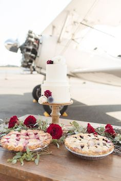 Photographer: Kelby Maria Photography | Event Planner: Willow & Ivy Events | Event Venue: Olympic Flight Museum | Calligrapher: Sarah's Inkwell | Bridesmaid Dresses: Weddings With Joy | Dress Store: Weddings With Joy | Makeup Artist: Rose and Crown Salon | Floral Designer: Diamond Events and Floral | Cake Designer: The Cake Walk Shop | Submitted via Two Bright LightsStyle Guide Aviation Wedding, Brave And The Bold, Classic Desserts, Strictly Weddings, American Wedding, Floral Cake, Event Venues, Wedding Vendors, Floral Design