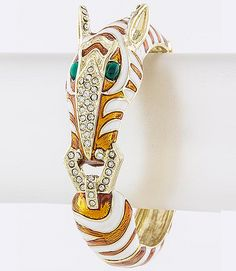 Chic bracelet designed with a zebra head and striping attached to a crystal studded...