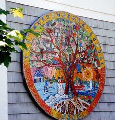"The theme of ""The Four Seasons"" combines with a Tree of Life in this twelve foot diameter school mosaic, installed on the playground wall of an elementary school. This mosaic was designed and made by students using Mexican smalti. This beautifully colored, easily cut glass mosaic is an ideal material for young artists, who work collaboratively to create the image in a jigsaw-like process that creates a Pointillist mural."