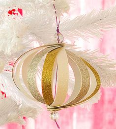 Paper Globe Ornament: We used glitter card stock for this craft, but using bright patterns or muted solids could give this stripey sphere a totally different look. Old Christmas, Christmas Ornaments To Make, Christmas Holidays, Christmas Bulbs, Christmas Decorations, Holiday Crafts For Kids, Holiday Fun, Christmas Crafts, Globe Ornament