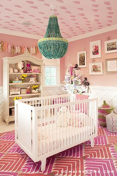 Kourtney Kardashian is always a trendsetter and her daughter Penelope's nursery shows her eclectic style. Love the ceiling! #pinkandturquoise #kourtneyknursery