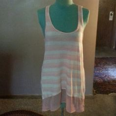 """Free People Tank Top Two toned light pink cotton tank top with lace trim around bottom has a high low hem style scoop neck line in front is 34""""long looser fitting Free People Tops"""