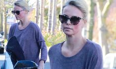 Charlize Theron is sophisticated chic as she dons low cut grey top