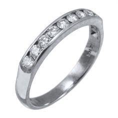 White gold and round channel set wedding band, with diamond going half way on the ring. Flat top to sit flush with your engagement ring. Priced upon request.