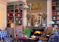 Another home of Charles Faudree - this living room features wing chairs in Petit Parc and a large check in blue and white.