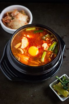 How to Make Soondubu Jjigae - Spicy Korean Soft Tofu Stew with Seafood. This dish is traditional Korean comfort food!