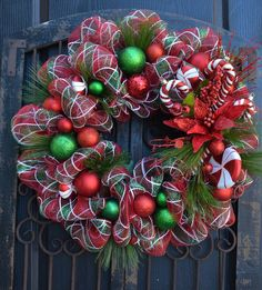 Deco mesh Red, White, Green Plaid Striped Wreath with Candy Cane and Poinsettia Accents..