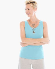 "Sleek and modern, this tank features a clean, simple line—a chic year-round layering piece.   Slimming scoop neck.   Extra stretch for a perfect fit.   Length: 24"".   Nylon, spandex.  Machine wash. Imported."