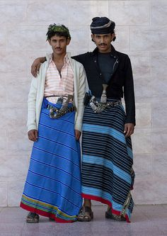 """Flower Men from Asir - Yemen & Saudi Arabia.  Habala (Arabic:حلبة) is a small mountain village in the 'Asir province of Saudi Arabia. It was originally inhabited by a tribal community known as the """"flower men"""" because of their custom of wearing garlands of dried herbs and flowers in their hair. In the past, the village was only accessible by rope ladder -- the name Habala comes from the Arabic word for rope."""