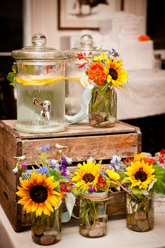 Sunflowers in mason jars dress up the beverage station