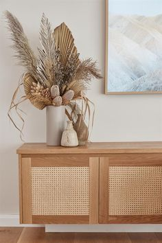 Loughlin Furniture: Our Pacific Entertainment Unit incorporates the raw beauty of timber together with an on-trend rattan feature, cleverly providing plenty of storage. Available as a free standing or wall mounted unit. Measures 2000 x 450 x 450 high.