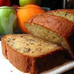 Rich Banana Bread    Ingredients:    1/2 cup butter, melted  1 cup white sugar  2 eggs  1 teaspoon vanilla extract  1 1/2 cups all-purpose flour  1 teaspoon baking soda  1/2 teaspoon salt  1/2 cup sour cream  1/2 cup chopped walnuts  2 medium bananas, sliced