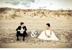 Great idea to sit on the sand instead of having all stand-up pics. Beach wedding photo prop
