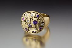 Alex Sepkus R-188S ring in 18k yellow gold with white diamonds and purple sapphires. DVVS Fine Jewelry