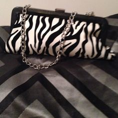 Taleen black & white zebra print clutch Taleen's fun black & white zebra print clutch with silver chain strap. Inside slip pocket on the lovely satin lining trimmed in soft black leather with a snap closure. Absolutely stunning!! Taleen Bags Clutches & Wristlets
