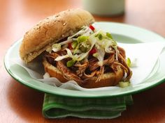 Slow Cooker Carolina Pulled-Pork Sandwiches:  I made this for dinner last night....so good!  I cut the vinegar down to 1/4 cup and we didn't do the slaw.