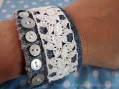 DIY denim cuff bracelet! Great use of some of the most popular materials out there right now.. especially the doily/lace aspect of the cuff.