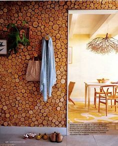 Tree slices as wall covering. I checked this out a while back. Like it but not for the whole wall, maybe an accent wall / backsplash. Or art/pic frames?