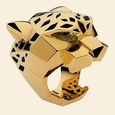 Cartier vintage large Panther ring in 18kt yellow gold. This is from my private collection of rings. It is worn on the middle finger of my right hand. It is bold, unusual & adorned by many.