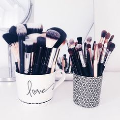 Use cute mugs to organize your makeup brushes!