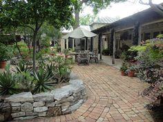 Love the open patio area - different seating area, extensive brick work, two raised beds, one island bed - just beautiful
