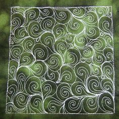 Spiral Petals - This filler combines spirals and paisley in a neat way with tear drops for a very simple free motion quilting design. Learn how to sew it at freemotionquiltin...