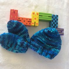 Hand knit in mixed shades of blue wool. These very small items are sized for a premmie baby - or doll's clothes. Shown in photo on a baby doll. Blue Wool, Main Colors, Shades Of Blue, Baby Blue, Fiber Art, Mittens, Hand Knitting, Baby Dolls, Knitted Hats