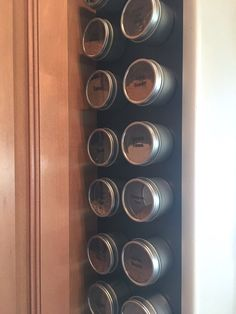 Spice tins sticking to magnetic wall