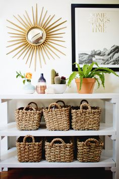 Love the organization of this..LOVE the pairing of the mirror and the framed quote (ps love that quote); LOVE the simple shelves w/ baskets and the top shelp groupings too.