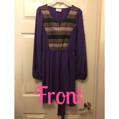 Dress This is a dress from a boutique. It's purple Aztec. Never worn. Ties in the back. Dresses