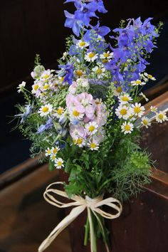 Tied posies for pew ends