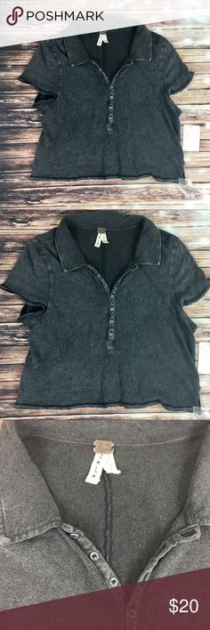 Free People Cropped Polo Style Top BNWT! Adorable Free People collared crops top, women's large. Loose fit. Would be perfect with high waisted bottoms, low rise or distressed jeans. Too is a distressed black/grey color. Snap button front. Free People Tops Tees - Short Sleeve