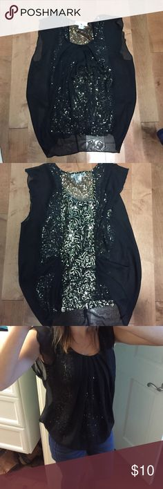 Flowy Sparkle Top Flowing black material lays over the sparkles underneath, super cute.  The back has a strip of sparkles. Tops Tees - Short Sleeve