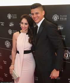 Marcos Rojo is all smiles on Tuesday night as he arrives with Eugenia Lusardo at the Man United Player of the Year awards at Old Trafford