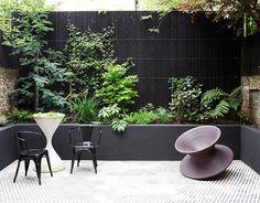 Green wall. Modern. Raised planters.