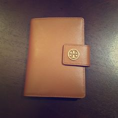 Tory Burch Robinson large passport holder very cute and functional!  5 card slots 3 large pockets for bills and passport 1 pen loop 1 zippered pocket for coins.No need to carry another wallet when traveling. Tory Burch Accessories Key & Card Holders
