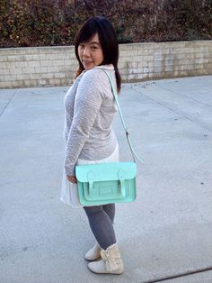 This ultra-stunning mint-green satchel, designed by The Cambridge Satchel Company in the UK, is absolutely saturated with style. From its sturdy, super smooth, genuine leather composition, to its long, adjustable shoulder strap, this versatile bag is much like a clearly outlined thesis or a well-written proposal - straightforward, uncompromising, and worthy of endless applause!