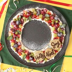 Fruit Pizza Christmas Wreath - Holiday Video Recipe With a giant cookie ring as the base, this is one Christmas dessert that's sure to be a hit at your holiday party! Christmas Snacks, Christmas Brunch, Xmas Food, Christmas Cooking, Christmas Parties, Christmas Holiday, Dessert For Christmas Party, Christmas Fruit Ideas, Healthy Christmas Party Food