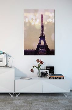 Adding a hint of wanderlust, Parisian-charm to the living space with this stylish and glimmering canvas art of the Eiffel Tower.