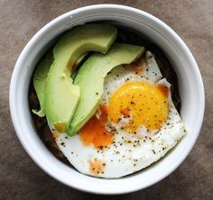 Breakfast, fried beans, over easy eggs and avocado