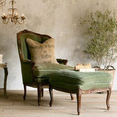 Walls with patina, a great chair and chandelier and that pillow too...