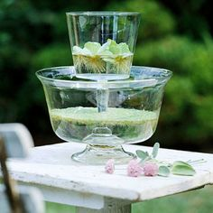 Easy Spring Centerpiece: Use floating plants to provide a layer of green that's perfect in stacked glass containers.