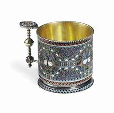 A SILVER-GILT AND CLOISONNÉ ENAMEL TEA-GLASS HOLDER  MARKED KHLEBNIKOV WITH THE IMPERIAL WARRANT, MOSCOW, 1877http://www.christies.com